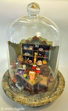 A lovely idea for a dolls house miniature display.