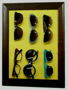 How to organize your sunglasses. Step 1 - buy a 8x11 frame (or bigger /smaller depending on how many you have). Step 2 - used cool a print paper or photo as background. Step 3 - place ribbons or strings with staple or paper fasters. Step 4 - hang sunglasses. Enjoy  G;)