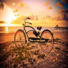 vintage bicycle on a beach at sunset