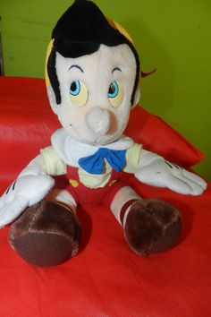 Boneco Pinóquio Pelúcia 35cm Walt Disney - R$ 70,00 no MercadoLivre