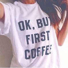 """""""Ok, but coffee First"""" Tee Super cute light tee. Size chart is in pictures. Pair with denim to complete this look. The material is polyester & the neck is an """"o"""" neck line. Won't stay in stock for long Tops Tees - Short Sleeve"""