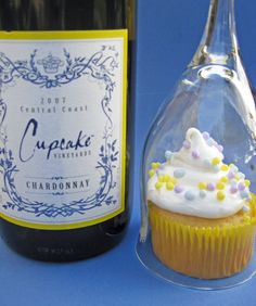 good idea for a party...everybody gets a cupcake and a wine glass. Cute table setup for when guests arrive. Maybe wine/champagne in the cupcake?