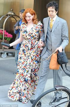 Christina Hendricks & Geoffrey Arend do couple chic. Love her dress!  She has such style and class!