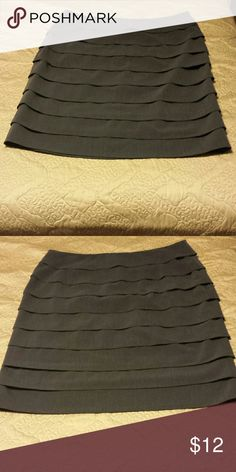 """Grey pencil skirt. Grey pencil skirt with flattering """"ruffles"""" or pleats? Would make a great skirt for work, church, etc. It has a side zipper and is fully lined. Great used condition, size 14. Larry Levine Skirts Pencil"""