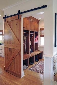 Country Mud Room with Custom barn door room divider reclaimed pine barn door, California Closets Custom Mudroom
