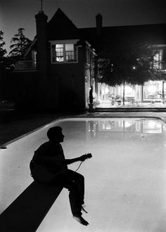 Ricky Nelsonplays guitar in the backyard of the Nelson family's Hollywood home in 1958 by Hank Walker. S)