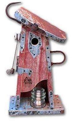 Birdhouse made of old wood, farm implements, glass insulators, and metal.