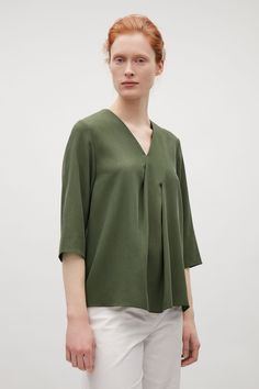 V-neck top with front pleats in Bottle Green