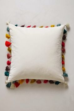 Firenze Velvet Tassel Pillow LOVE THIS. They show two sizes - square, and more of a rectangle neck rest shape. regardless - the colorful tassels 'make' the pillows and suddenly fills my head with thousands of comparable ideas! Diy Pillows, Decorative Pillows, Throw Pillows, Accent Pillows, Cushion Covers, Pillow Covers, Diy Tassel, Velvet Cushions, White Cushions