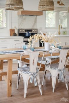I'm SO excited to share the kitchen makeover at our Little Lake House with you today!! We ripped this room right down to the studs, re-designed it and DIY renovated it to a modern coastal dream space. Click here to watch the NEW YOUTUBE VIDEO and photos of the entire renovation from start to finish: Modern Beach Decor, Seaside Decor, Modern Coastal, Dining Room Table Decor, Dining Room Design, Kitchen Design, Kitchen Renovation Inspiration, Kitchen Inspiration, Coastal Cottage
