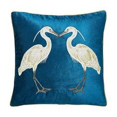 Complete with a luxurious, velvet textured finish this teal blue cushion is decorated with a gold trim and a bold heron design and comes with a plump polyester hollowfibre filling.
