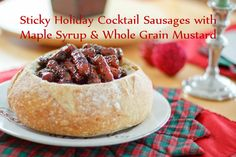 Nigella Nosh: Sticky Holiday Cocktail Sausages with Maple Syrup & Whole Grain Mustard