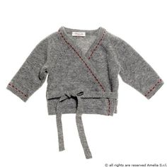 A classic style in girl baby knitwear : crossed wool sweater with hand made stitchings superfine 100% wool