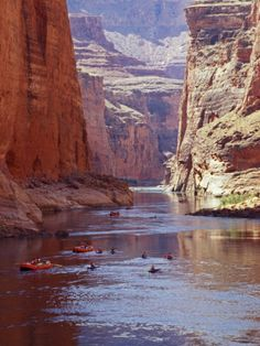 Kayaks and Rafts on the Colorado River passing through the Inner Canyon, Grand Canyon, Arizona -- by John Warburton-lee