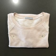 """Cream top with pretty detail. Perfect for spring. Light weight woven short sleeve pullover sweatshirt in light taupe/cream. It's between light and mid weight fabric.  This would be a cute work top, too. It's not just for your time off! . Soft cotton/poly/rayon blend.  In new condition - never worn not washed.  20"""" across underarms.  25"""" from neck to hem. 2nd & 4th pics reflect the true color. Olivia Moon Tops"""