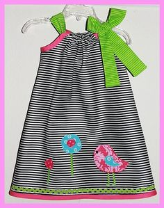 I love how this dress turned out, so whimsical and sweet. The dress is a pillowcase style that was made with a cotton black and white stripe fabric and features an appliquéd bird and circle flowers. This dress looks super cute alone or paired with leggings and an undershirt.    Please leave size ...