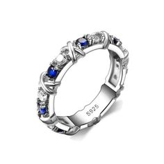 - Material: Sterling Silver - Stones: Synthetic Blue Sapphire - Face Height: 4 mm - Band Width: 4 mm - Size (Varies)