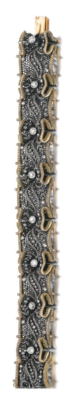 DIAMOND BRACELET, BOUCHERON, 1900S The blackened platinum ribbon, modelled to resemble lace, embellished with foliate motifs, highlighted with circular-cut and rose diamonds, length approximately 180mm, signed Boucheron, French assay and marker's marks.
