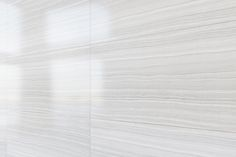 Artistic Tile | Matrix Bright Wall | Made in the USA, MATRIX is a collection of large format porcelain tiles. Lightly brushed to accentuate its linear veins, MATRIX has the look and feel of brushed stone in a low maintenance, highly durable material. Available in five distinct colorways, MATRIX is an excellent choice for high traffic areas in your home, office or other commercial space.