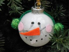 Snowman Ball Ornament    This cute snowman is easy to make and fun to hang on the tree. Make extras to give as gifts!  Basic materials: Glass ornament, paint, felt, yarn, chenille stem, yarn