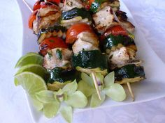 Chicken and veggie skewers marinated in cilantro, lime, and cumin. Serve with rice, salsa, and warm tortillas. Veggie Skewers, Chicken Kabobs, Marinated Chicken, Kebabs, Fresh Salsa, Fresh Coriander, Caprese Salad, Cherry Tomatoes, Allrecipes