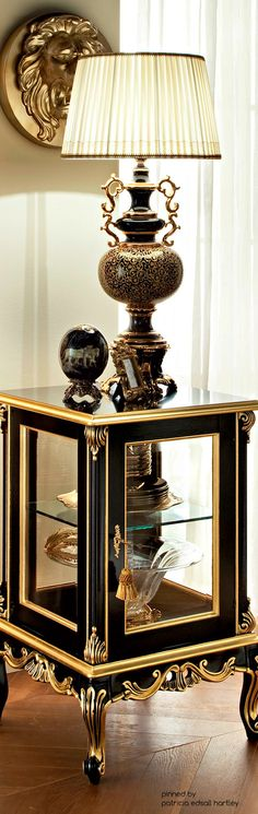 Certainly My Kind of Style!!  #BlackandGold All Over!! And That Gold Lion Head Plaque!!