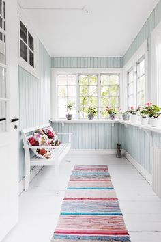 ~welcoming sun porch bench~ I love the shelves around the windows and the color on the walls.