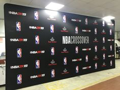 Just look how beautiful this custom Tension Fabric Display turned out we did for NBA Crossover 😍🏀🎮 Did you know we can print any custom size? Call us today and find out! Fabric Display, Trade Show, How Beautiful, Crossover, Photo Booth, Printing On Fabric, Nba, Backdrops, Audio Crossover