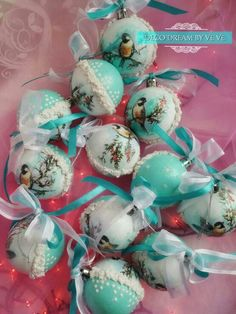 Handmade Christmas decoration balls in mint colour using winter motif of little birds.
