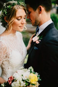 Love the bride's dress, simple updo and flower crown. The groom's look is dapper too