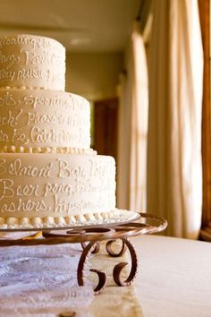 wedding cake with inside jokes and memories written on it - LOVE this idea