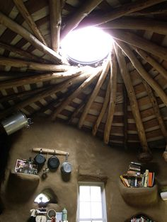 Skylight roof and storage in a cob house.
