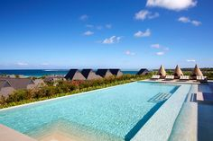 """Intercontinental Fiji Golf Resort & Spa. This stylish, 271-room hotel with four pools is the perfect place to kick off your Fiji honeymoon on the main island of Viti Levu. You'll be sunbathing on palm-tree dotted Natadola Beach, one of Fiji's best. The second coolest bathing spot? Your room's """"Cleopatra Bath""""—a deep tub for two on the balcony or terrace."""
