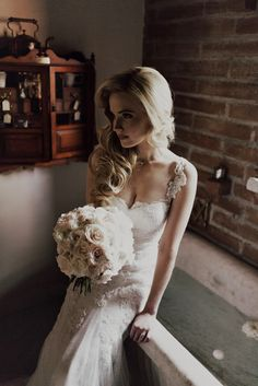 Spreading floral love.: Pure glam for this San Juan Capistrano wedding.  Photo by:  Logan Cole  Flowers by:  Floral Occasions  Bridal bouquet