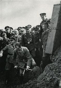 Hitler digging the first shovelful of earth at the ceremony for the Reichsautobahn, Frankfurt, Germany, 1933
