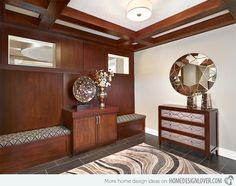"""Can you tell us which element in this entry way that appeals much to you? The vase, table sculpture, bench upholstery, area rug, ceiling, mirror and others are awesome! This is indeed one foyer that screams """"welcome""""! #design #foyers"""