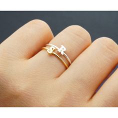 A dainty initial ring.