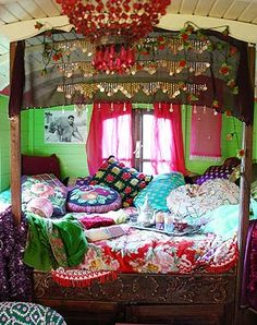 An inspiration photo for the guest room, otherwise known as Aslan's tent. The inside must, of course, have fabric-draped walls like a tent, but I'm going to base the decor on a gypsy caravan bedroom.