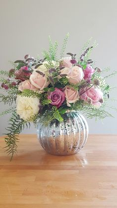 Gorgeous mix of pink and ivory roses, with ferns and herby foliages.  Flowers by Spriggs Florist