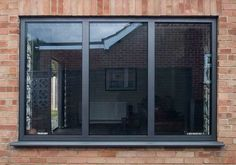 Browse our custom made aluminium windows. From casement windows with top hung, side hung or tilt & turn openings to large picture and corner windows. Black Vinyl Windows, Grey Windows, Pvc Windows, Basement Windows, Sliding Windows, Aluminum Windows Design, Aluminium Windows And Doors, Grey Window Frames, Home Deco
