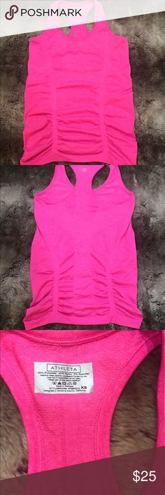 Athleta Fastest Track Ruched Tank Great condition!  Super lightweight and comfortable! Measurements are included in the pictures. No rips, stains, tears etc.  Let me know if you have any questions! Athleta Tops Tank Tops