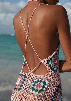 This pastel colored v-neck maxi dress is hand-crocheted by skilled Syrian & Turkish artisans and features a multicolored floral mosaic pattern. This 1970's inspired form-hugging dress with comfortable thin straps and an alluring low back will have you embracing your inner bohemian goddess!