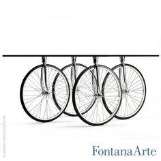With beveled float glass top, Tour Coffee Table has wheels taken from bicycles. #fontanaarte #coffeetable #gaeaulenti Available at loftmodern.com  http://www.loftmodern.com/products/fontanaarte-tour-coffee-table