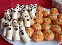 Ghost bananas! Not sure what is used for the eyes and mouths in this picture but I would use chocolate chips. Orange pumpkins and I would use mikes & ikes. Doing this its healthy with a small treat!