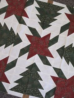 Forest Blooms Table Topper. Designed by Antler Quilt Designs. Kits available at www.hollyhillquiltshoppe.com