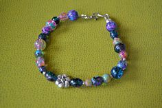 Hey, I found this really awesome Etsy listing at https://www.etsy.com/listing/265354914/vivid-color-beaded-bracelet-with-tibetan