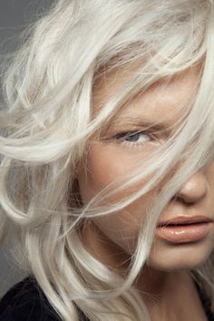 Platinum/white blonde hair + velvety skin + pale peach blush on cheeks + nude lips with a touch of gloss.A perfect match!
