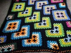 Love this twist on a granny square blanket!: