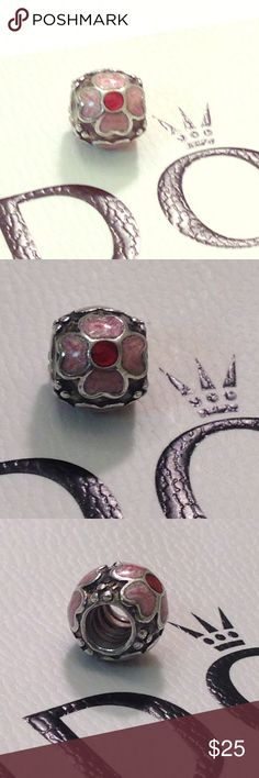 Authentic Pandora enamel pink flower charm. Authentic Pandora pink and red enamel flower charm. Pre-loved, good condition. Pandora Jewelry Bracelets