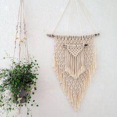 Macrame wall hanging for your boho decoration. Made of two parts. Made of cotton and wood  Measurements : piece of wood : 36 cm / 14,17 inches  Macrame itself : 27 cm / 10,62 inches width 52cm / 20,47 inches lenght